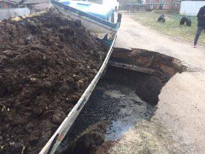 КамАЗ провалился под землю в Смоленском районе
